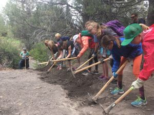 Please Volunteer: Sign Up to help Durango Trails 2000 at the Rocky Mountain Chocolate Factory Holiday Bloomer Sale